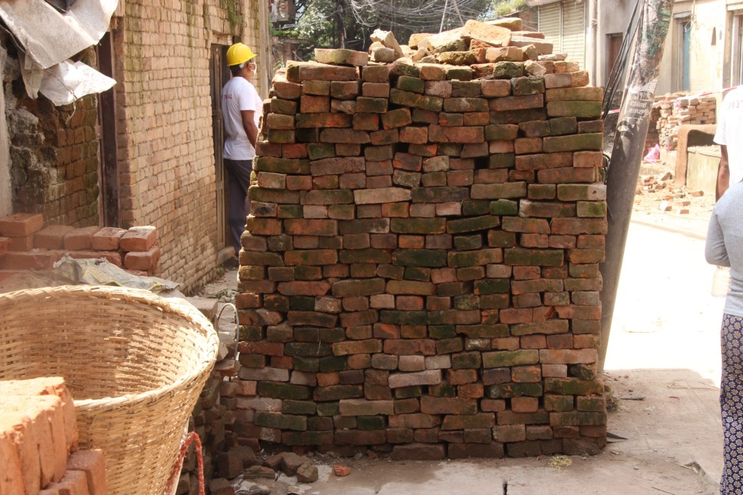 A family had stacked these bricks to try and construct some sort of wall for their home