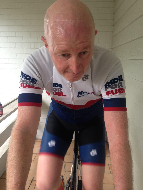Man sweating on bike