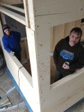 two men standing in a corner