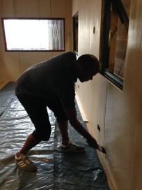 Leonard oils the walls very professionally