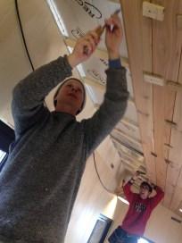 Dan and Adrian install thirteenth Ceiling board