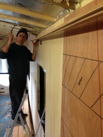 Master Craftsperson Adrian Hopper plans the inhalation of the first ceiling plank