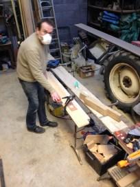 Greg sanding ceiling planks
