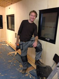 Master Craftsperson Stephen Cabin Man happy after the first day's work putting up the ceiling