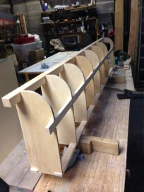 The curved wall gets more shelves added