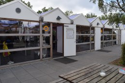 The kitchen facilities, the indoor dining area and the information kiosk/campground store.
