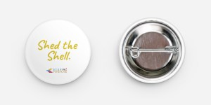"""Round 1.25"""" button pin, with """"Shed the Shell"""" written in yellow on white background. Includes StepIn2Purpose logo."""