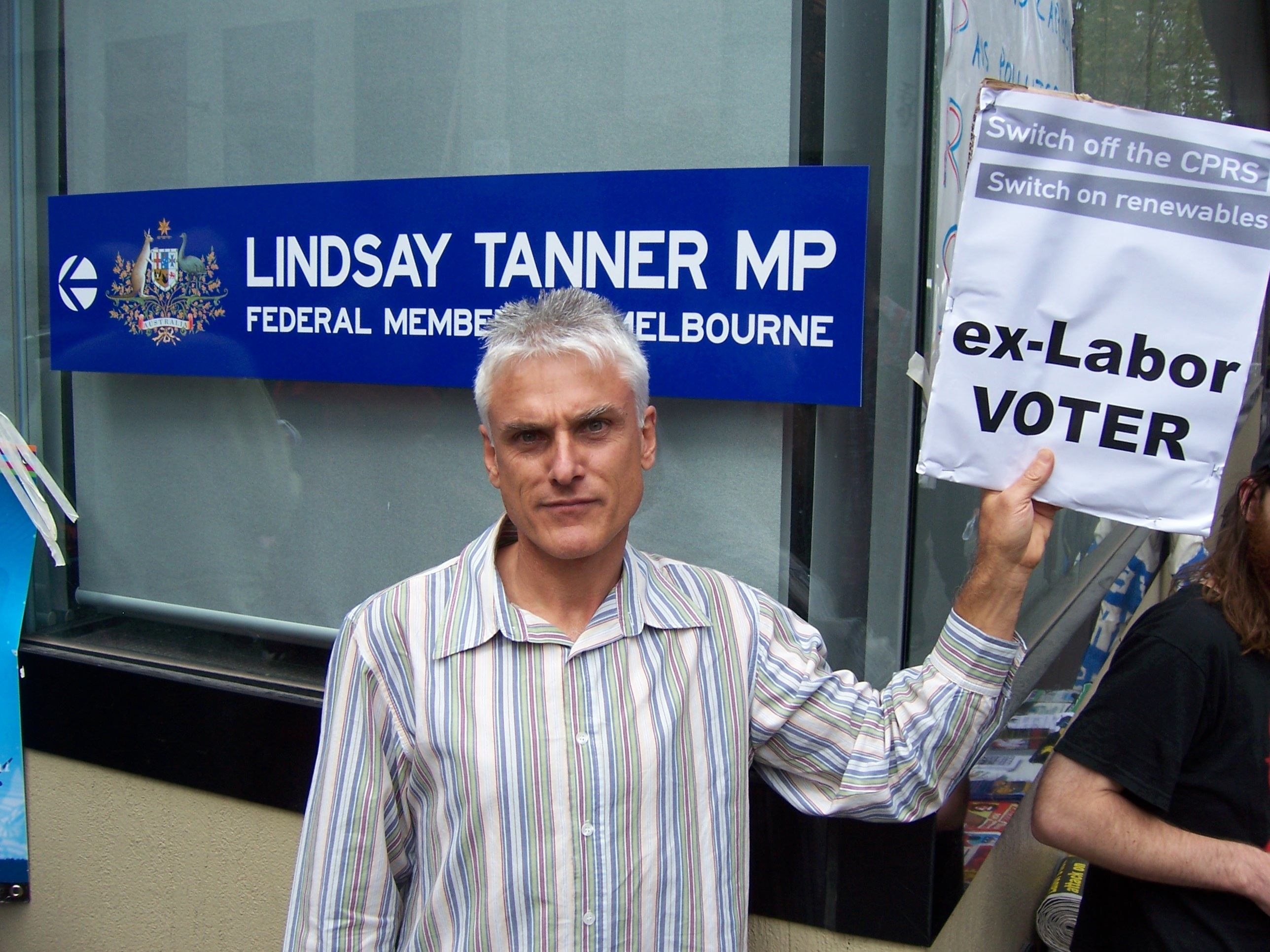 Disgruntled climate activist outside Tanner's office