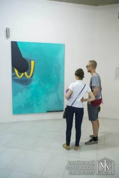 Uzhhorod-born artist Andriy Khir gauging the depth of his colleague's vision at UCU Contemporary Art Gallery in Lviv