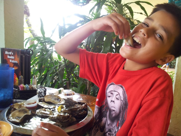 muddy waters-pic -8 yr old-Mateo- eating oysters 1