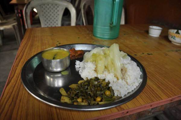 "food at the ""sumo"" stand at Sonari, before start the trip to Mon. Assam"