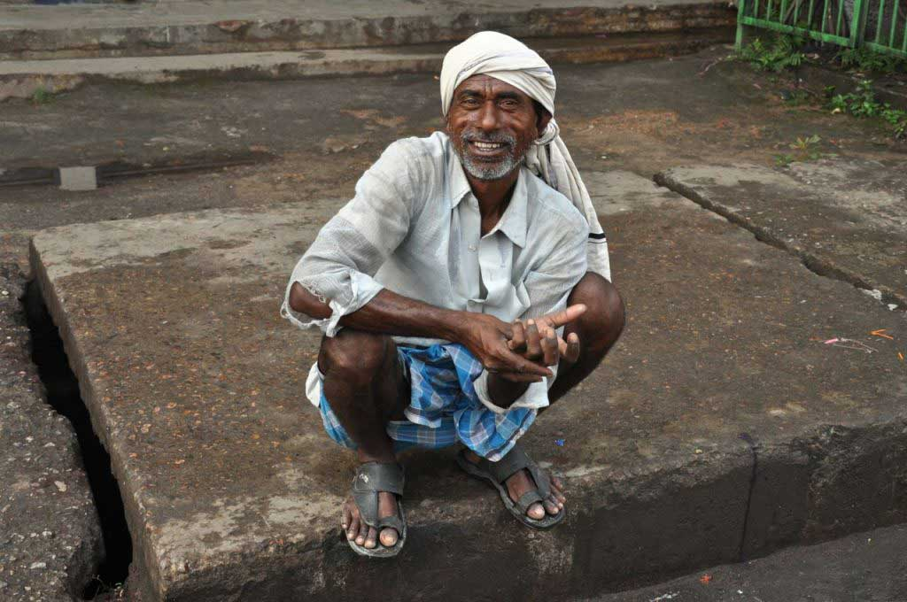 """paan"" chewer in the streets of Guwahati, Assam, India"