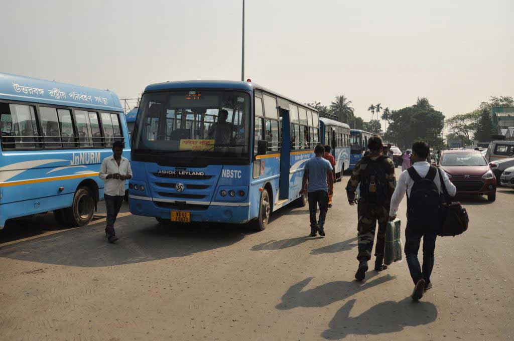 bus from New Jalpaiguri Junction (in front of the train station) to Panitanki