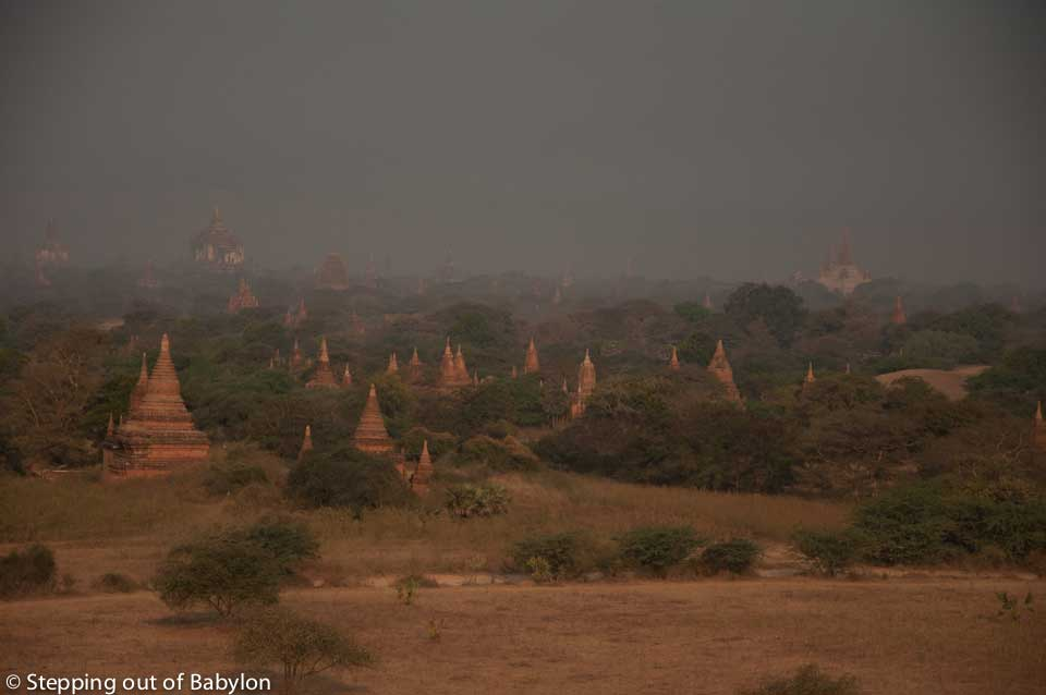 During the afternoon the landscape is wrapped in a layer of mist resulting from the heat. Bagan, Myanmar