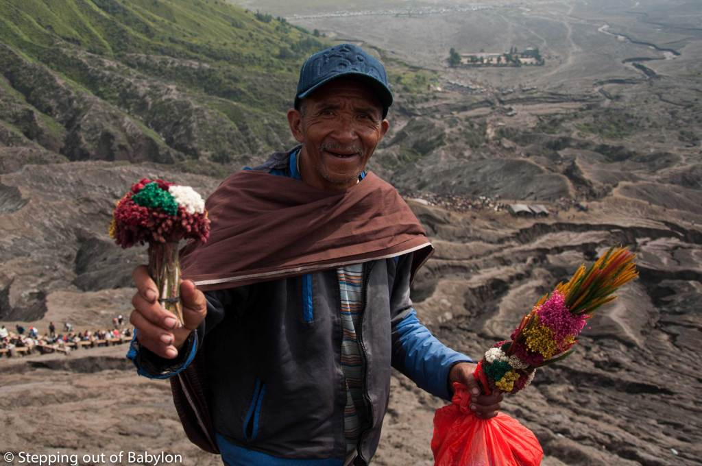 Selling flowers to trow to the Bromo crater to pacify the volcano