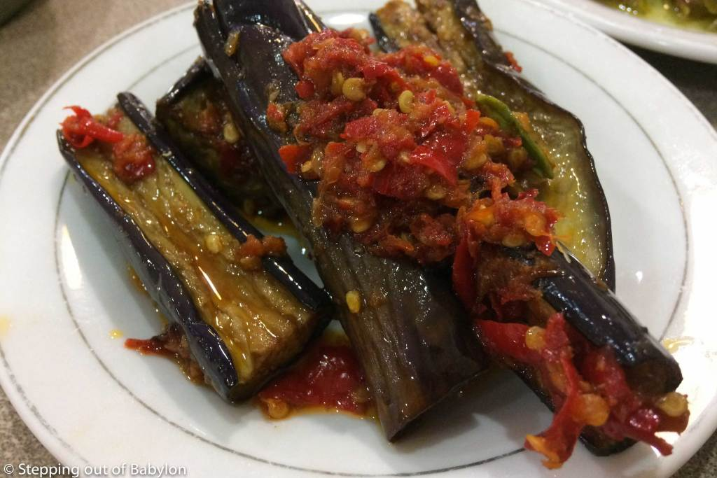 At Sumatra the eggplant is widely popular, grilled and seasoned with a chilli sauce... looks spicy due to the red colour but n fact is sweet and very tender.