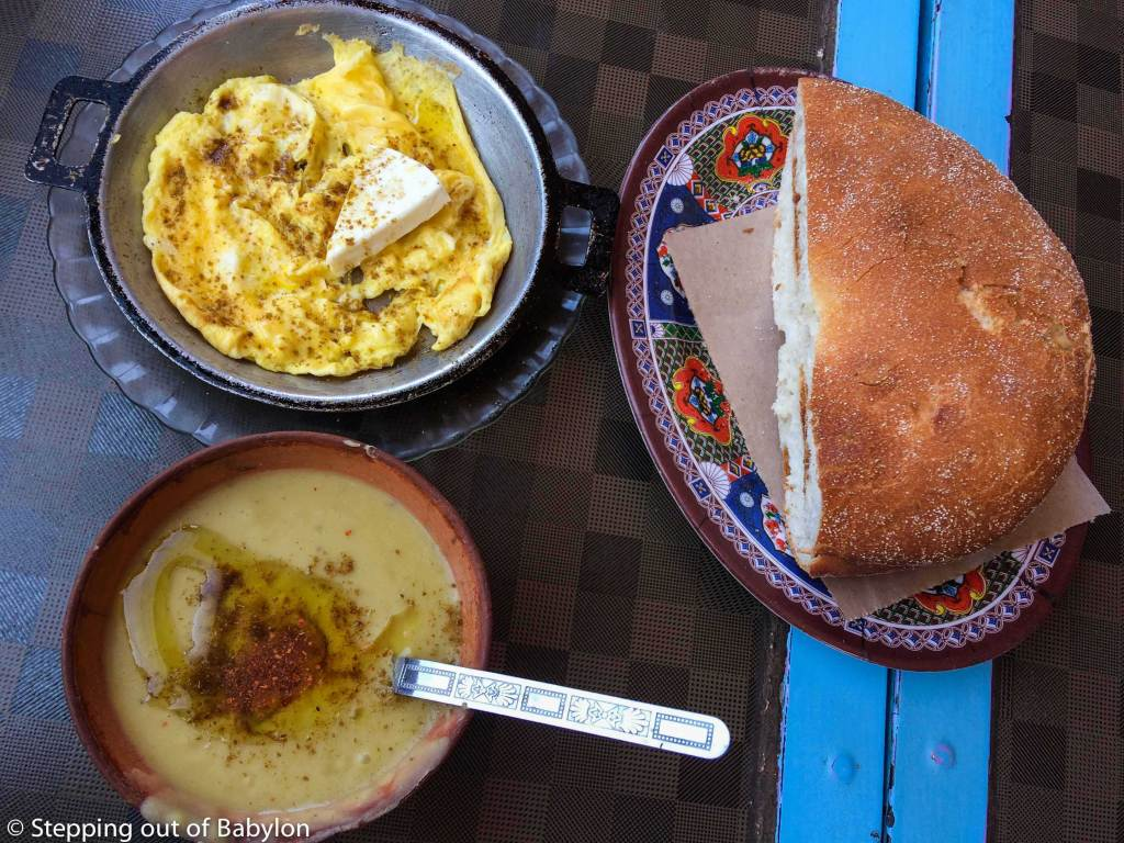 delicious breakfast at Ouarzazate main square... forget the western breakfast standards and enjoy this strong local brekafast with soup, bread and eggs... the triangle cheese is a trace of the french presence in Morocco