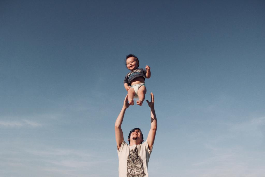 dad throwing baby boy in the air
