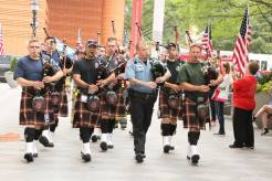 image of steve playing bagpipes with a bagpipe troupe at T2T Charlotte 2016