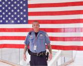 image of steve standing in front of the us flag at Climb for a Calling Ft. Worth 2017