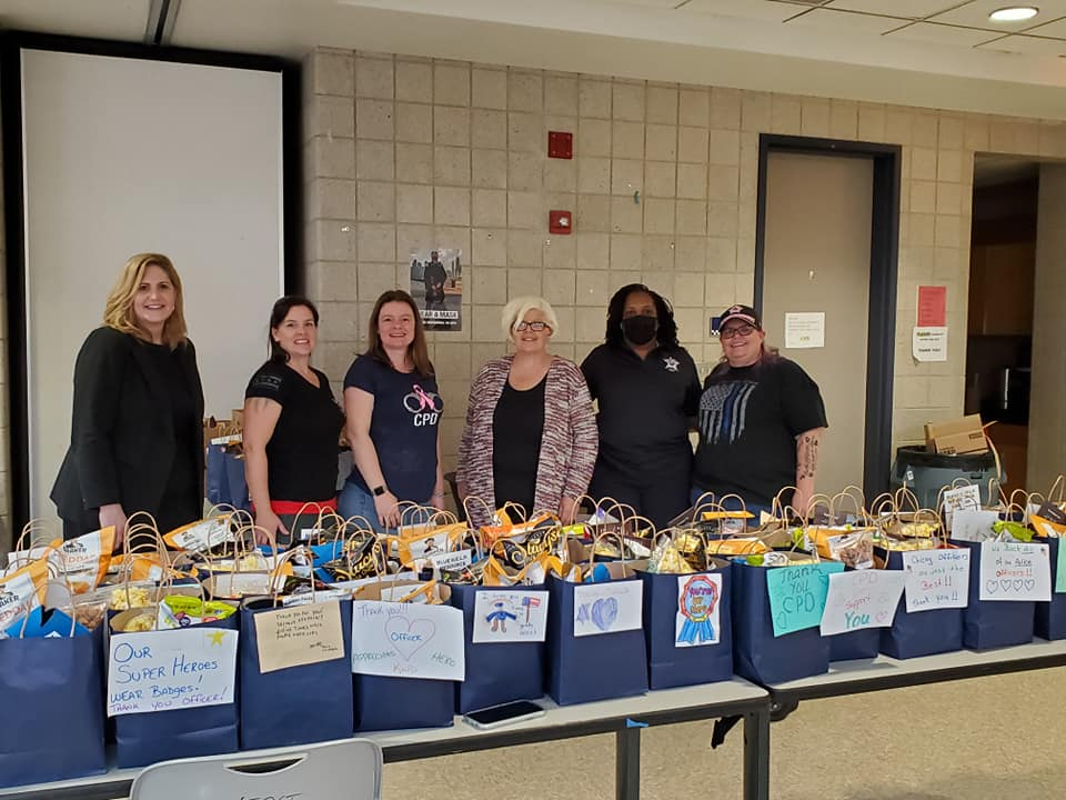images of smiling women helping with care packages for the chicago police department, aka Operation Blue Bag