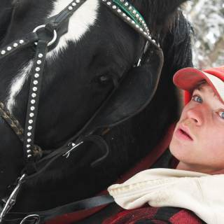 photo of student with a horse