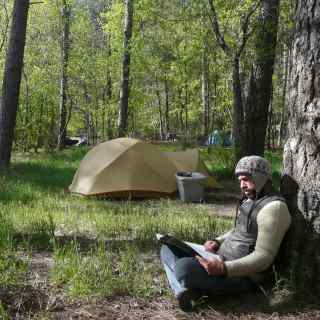Campsite and person looking at a map