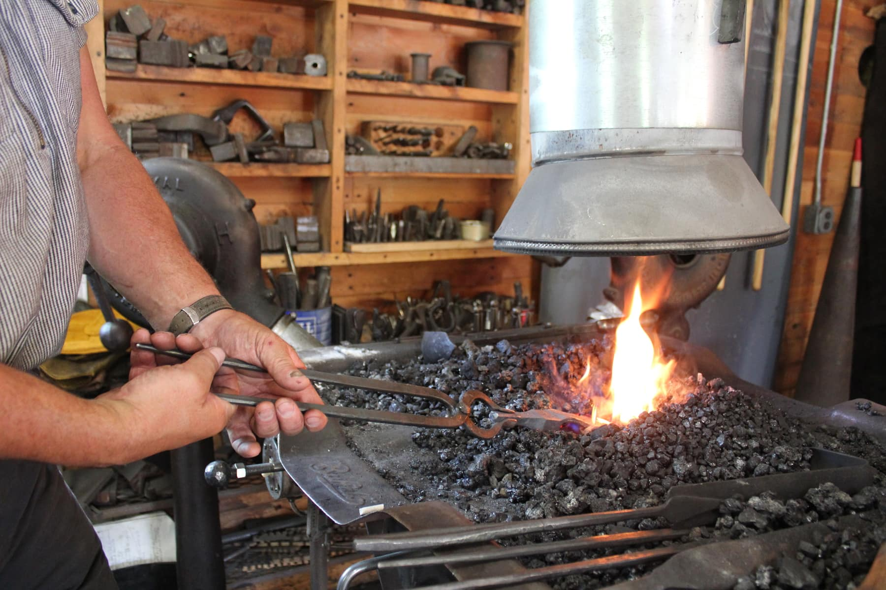 Heating the metal in the blacksmithing class
