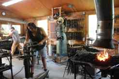 The typical scene in the blacksmithing class