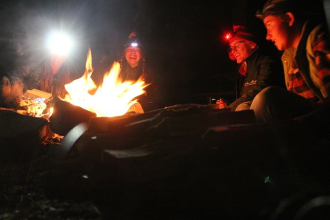 Students sit around a campfire on the California GFS trip