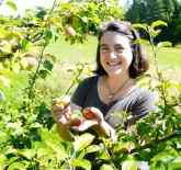 Eleanor Leger, co-founder of Eden Specialty Ciders, standing in her orchard