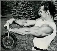 Exercises that are Often Neglected for Massive Gains - Bodybuilder performing forearm roller