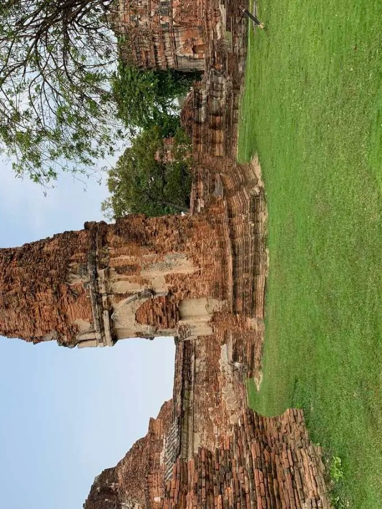 stupa that's leaning due to flooding