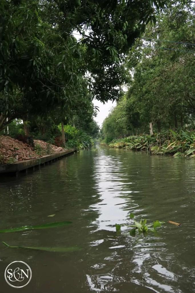 Boating along the canal to Damnoen Saduak Market! So pretty!