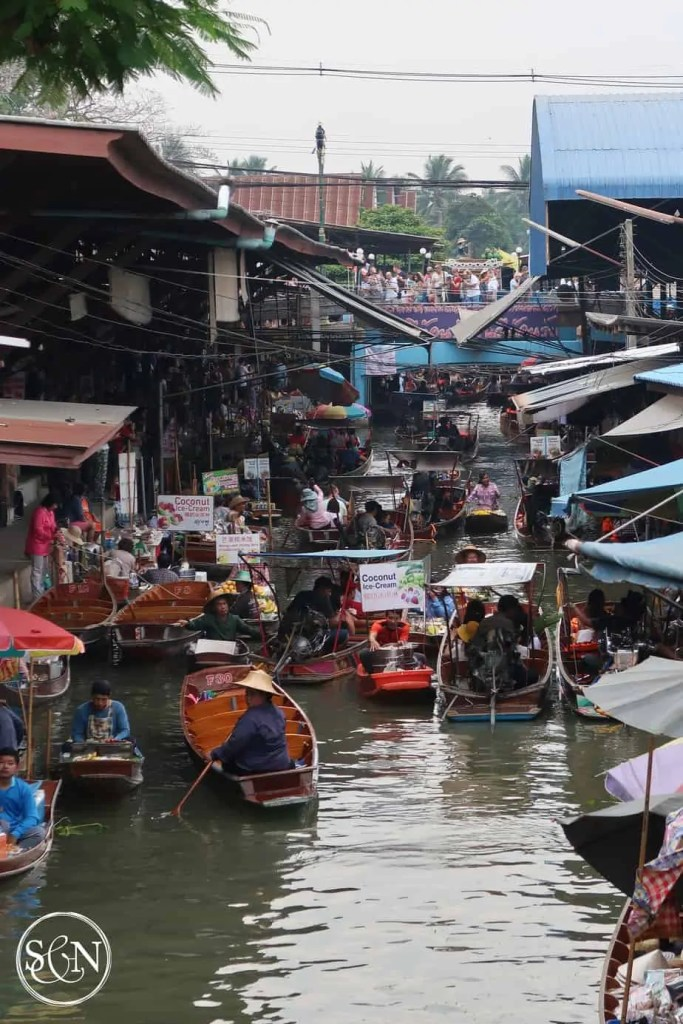 Boat traffic jam! Touring the Damnoen Saduak Floating Market is one item on both our bucket lists! Come along as we explore the boats, vendors, foods & sights along the way.