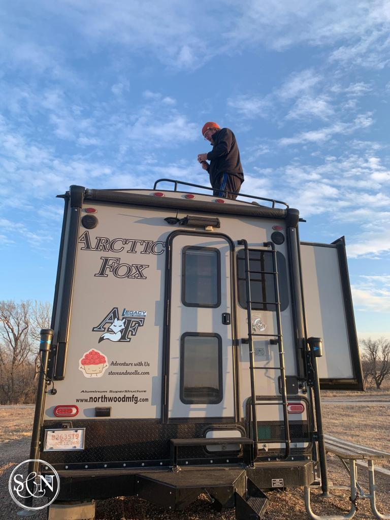 truck camper repairs on top of the roof