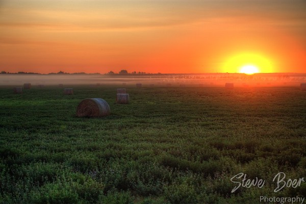 Foggy Hayfield Sunset
