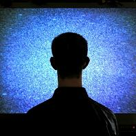man_in_front_of_tv
