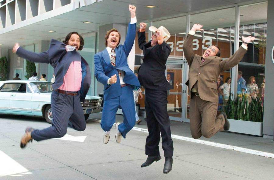 Ron Burgundy and the Channel 4 News Team (from the film Anchorman: The Legend of Ron Burgundy) jumping into the air