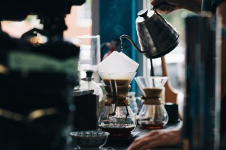 A Chemex pour-over being prepared in a coffee shop
