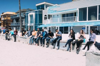 Members of 10up's Arrested Development group enjoying tacos along Mission Beach in San Diego, California