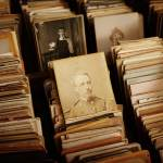 Stacks of vintage, sepia-toned photographs