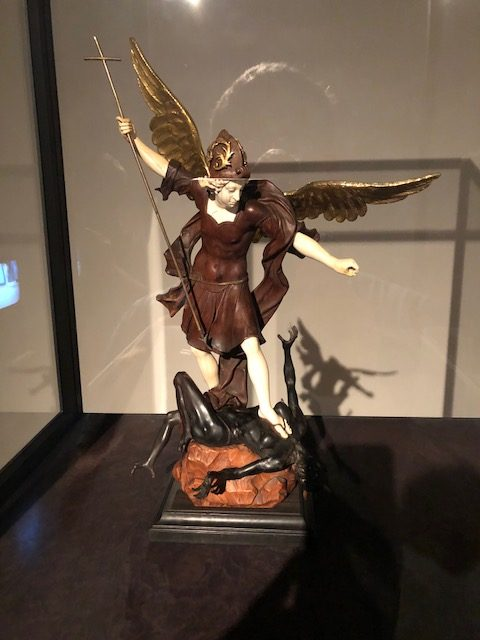 The archangel St. Michael battling a demon. Artist is Simon Troger, made in Munich around 1725, of walnut, ebony, ivory, glass and copper