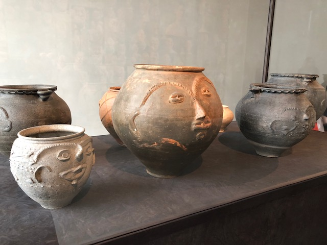 Urns with faces on them from the 3rd century. Kinda cute!