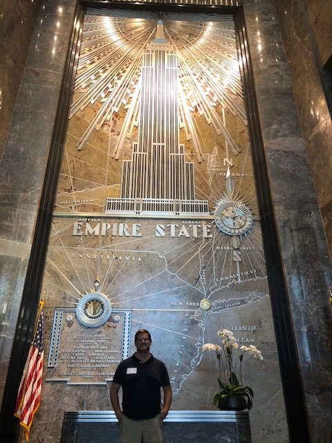A beautiful art deco piece of Empire State Building in the lobby