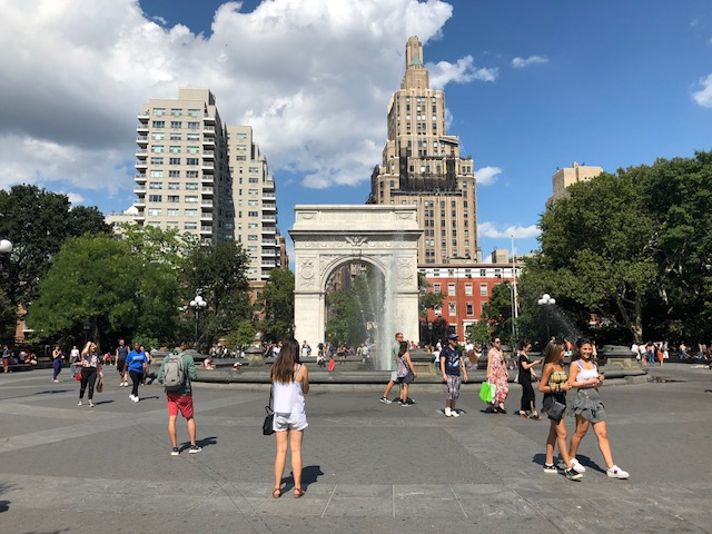 The fountain in Washington Square with the arc behind it