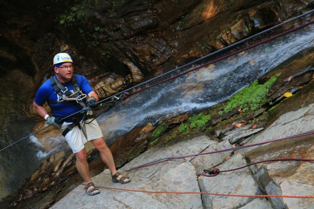 The first rappel straight down, next to a waterfall.
