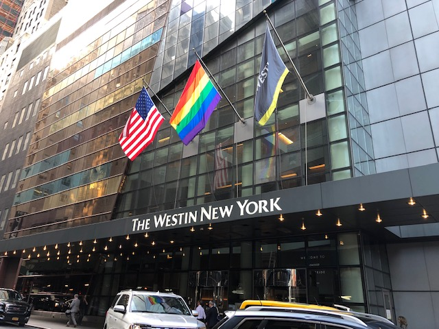 US, Rainbow and Westin flags over the entrance to the hotel
