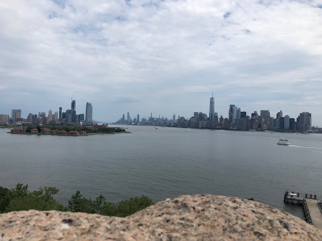 Downtown NYC and Jersey City under and overcast sky