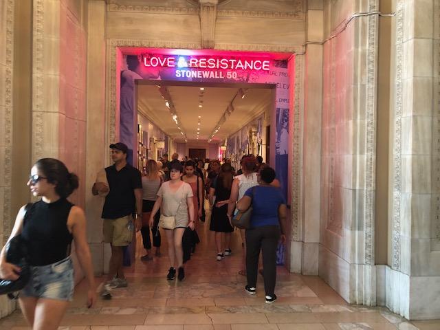 Sign aboe door entering a hallway: Love & Resistancce, Stonewall 50